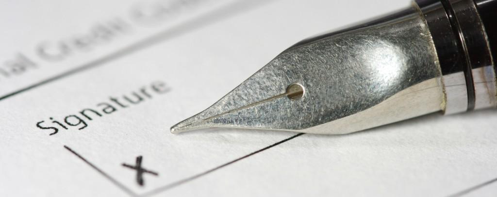 metal fountain pen on signature paper
